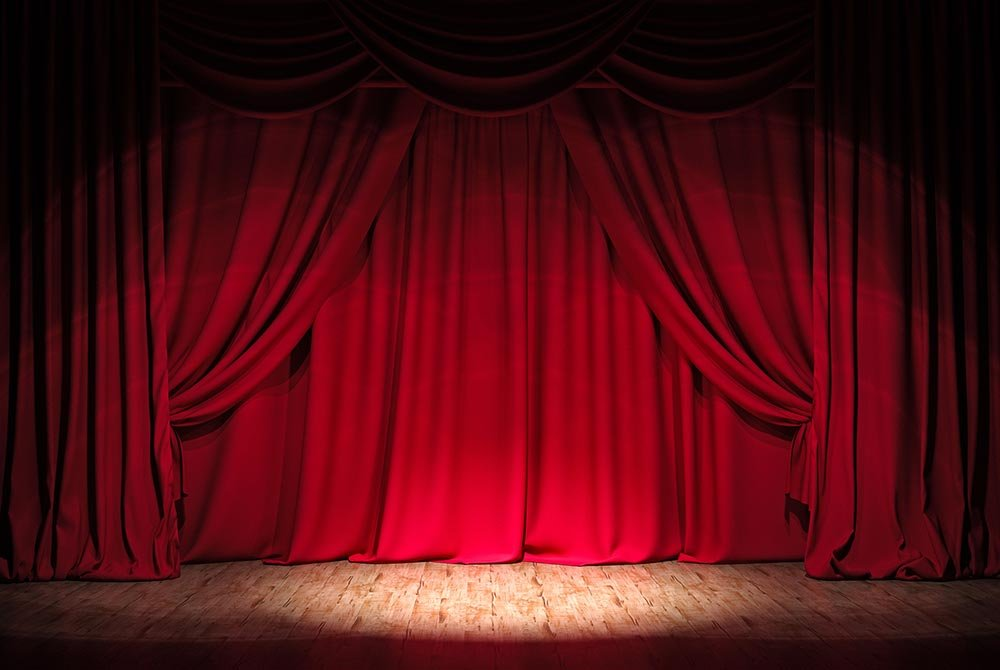 spotlight on red curtain and stage