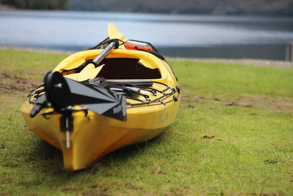 Kayak in field next to water