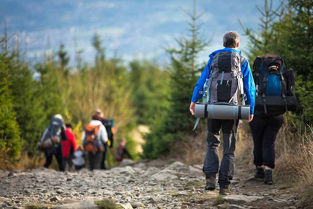 People hiking rocky trail