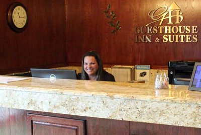 woman sitting at hotel front desk