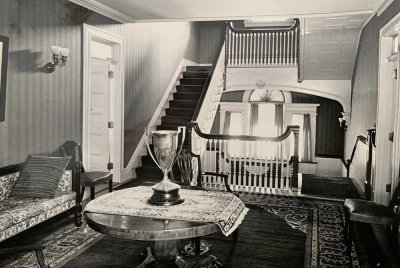 Old photo of trophy next to staircases