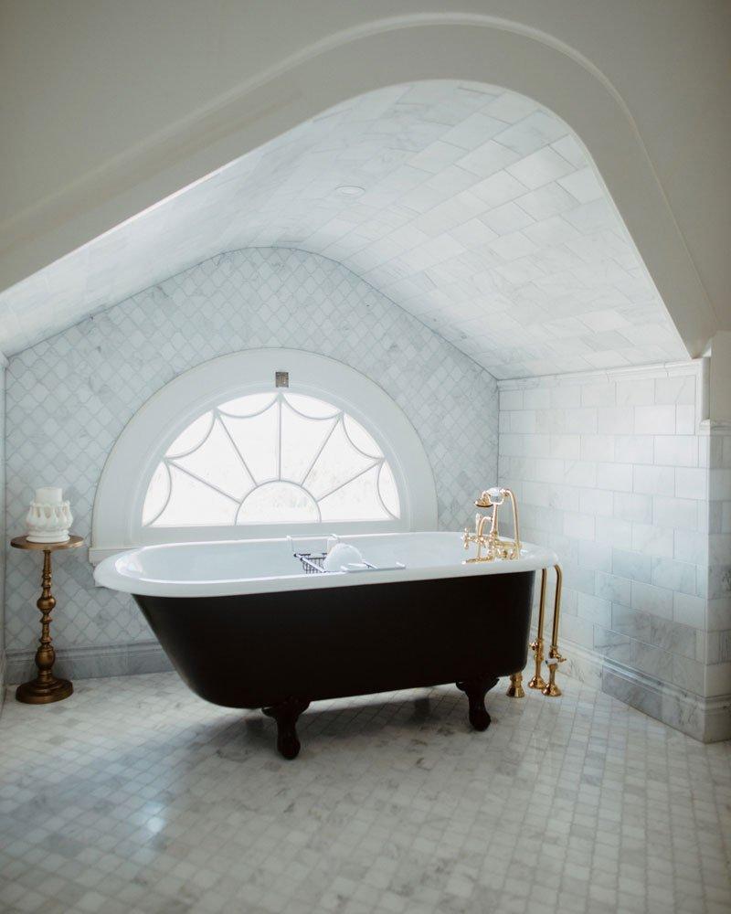 Bathtub in front of window
