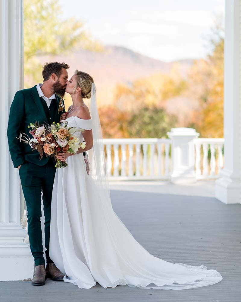 Bridge and groom on the porch