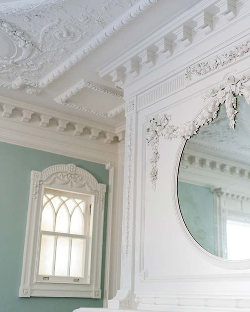 Mirror and window on walls of room
