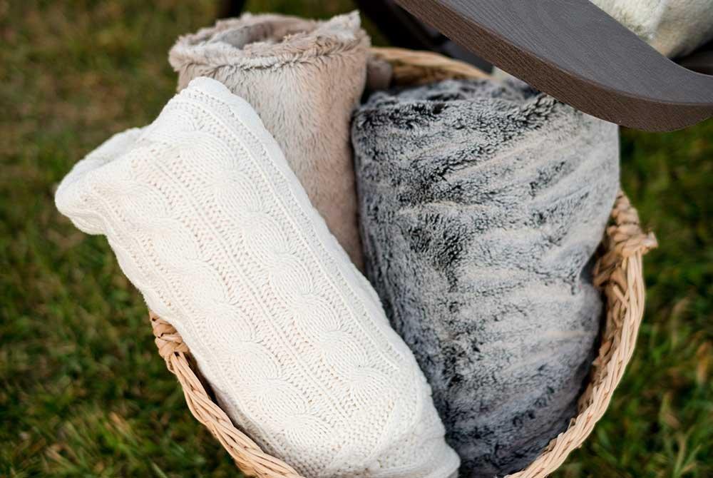 three fuzzy blankets in a basket