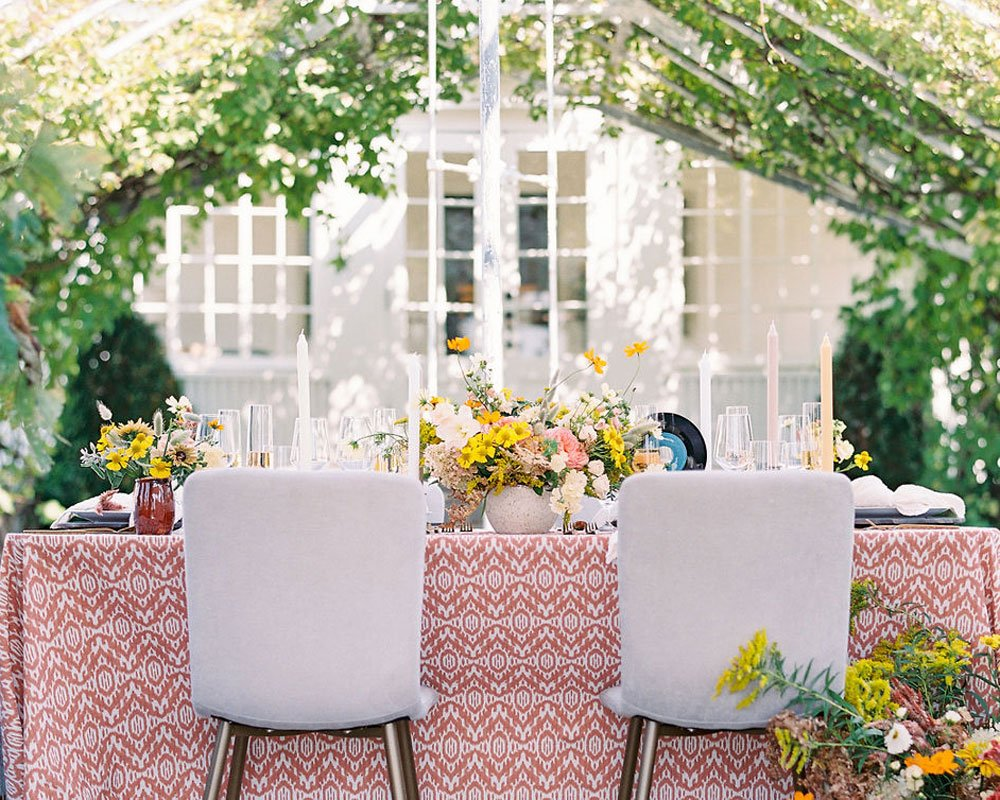 Decorated wedding table in greenhouse