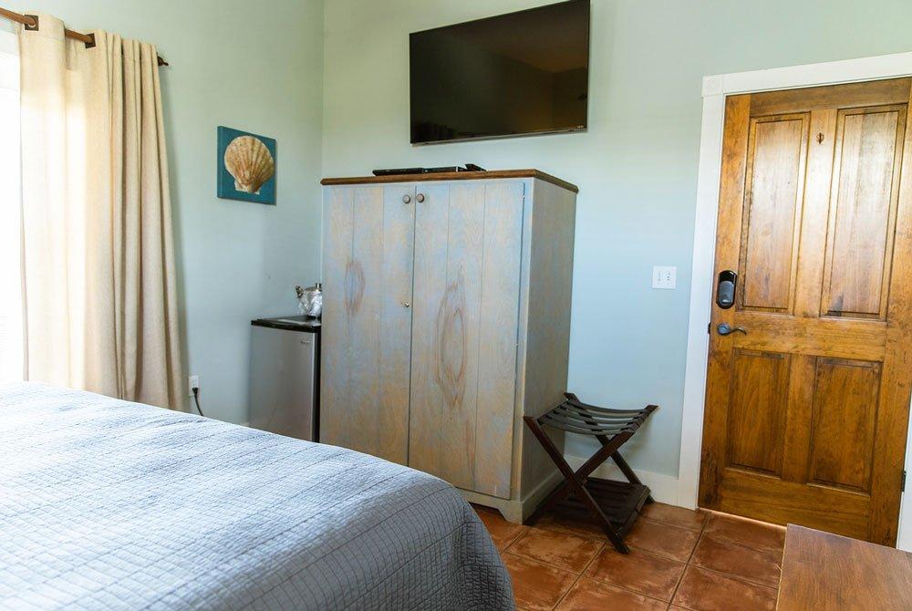 Dresser and porch door across from bed
