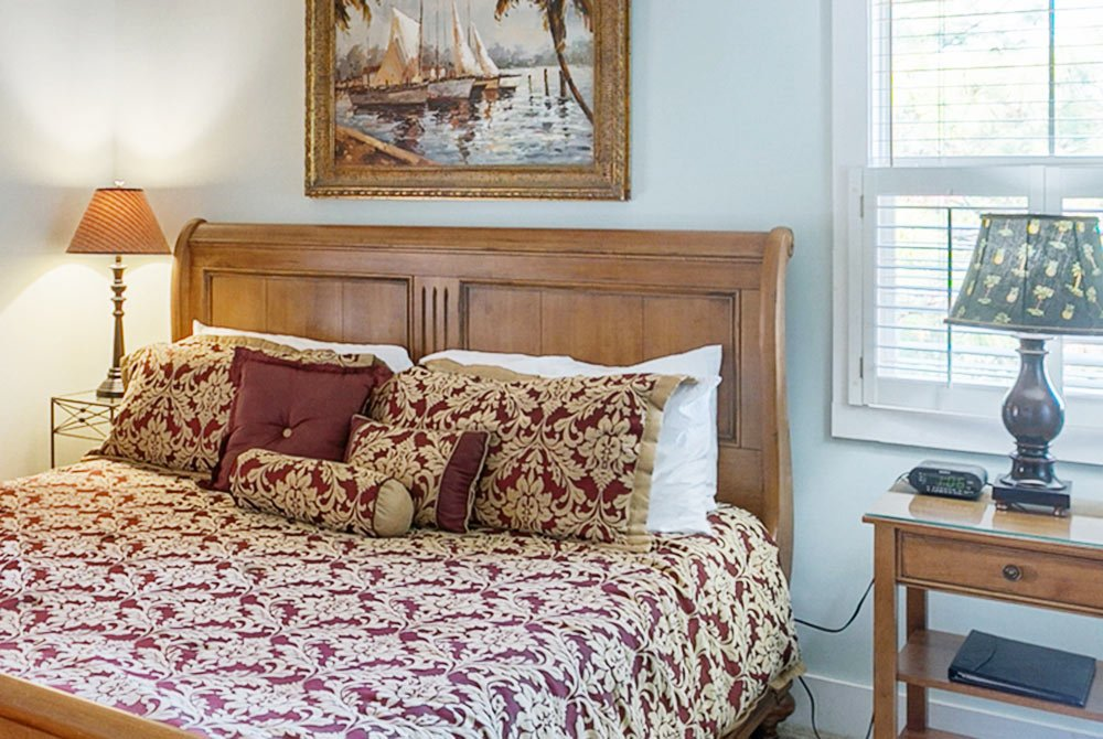 large bed next to side tables and lamps