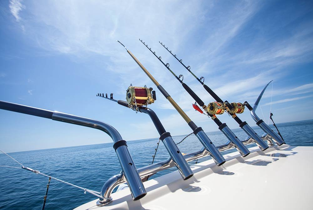 fishing poles propped on the deck of a boat