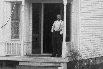 Man standing in doorway in old photo