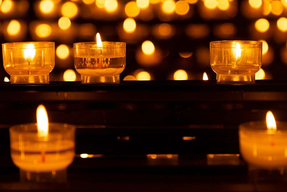 Candles lit in glass bowls