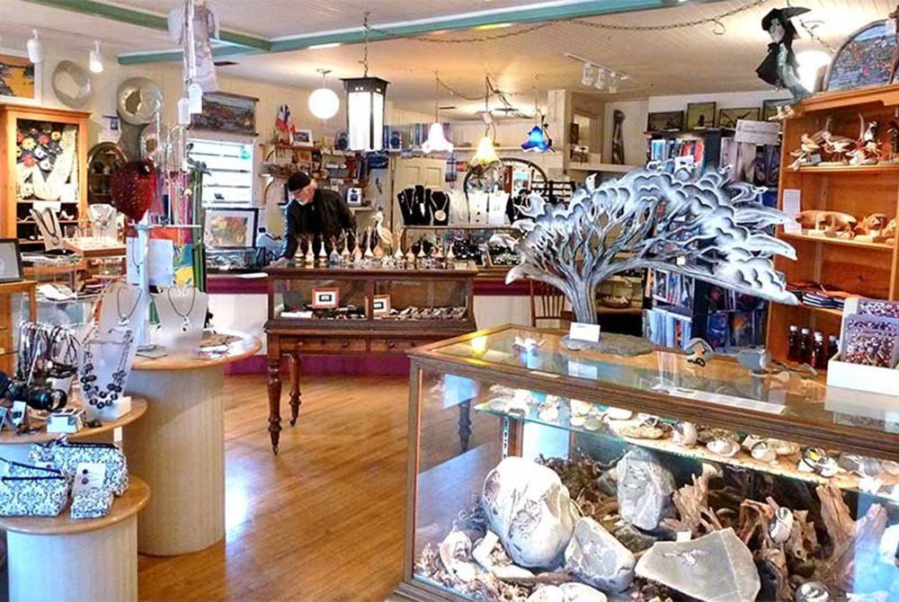 Displays of jewelry and art in shop