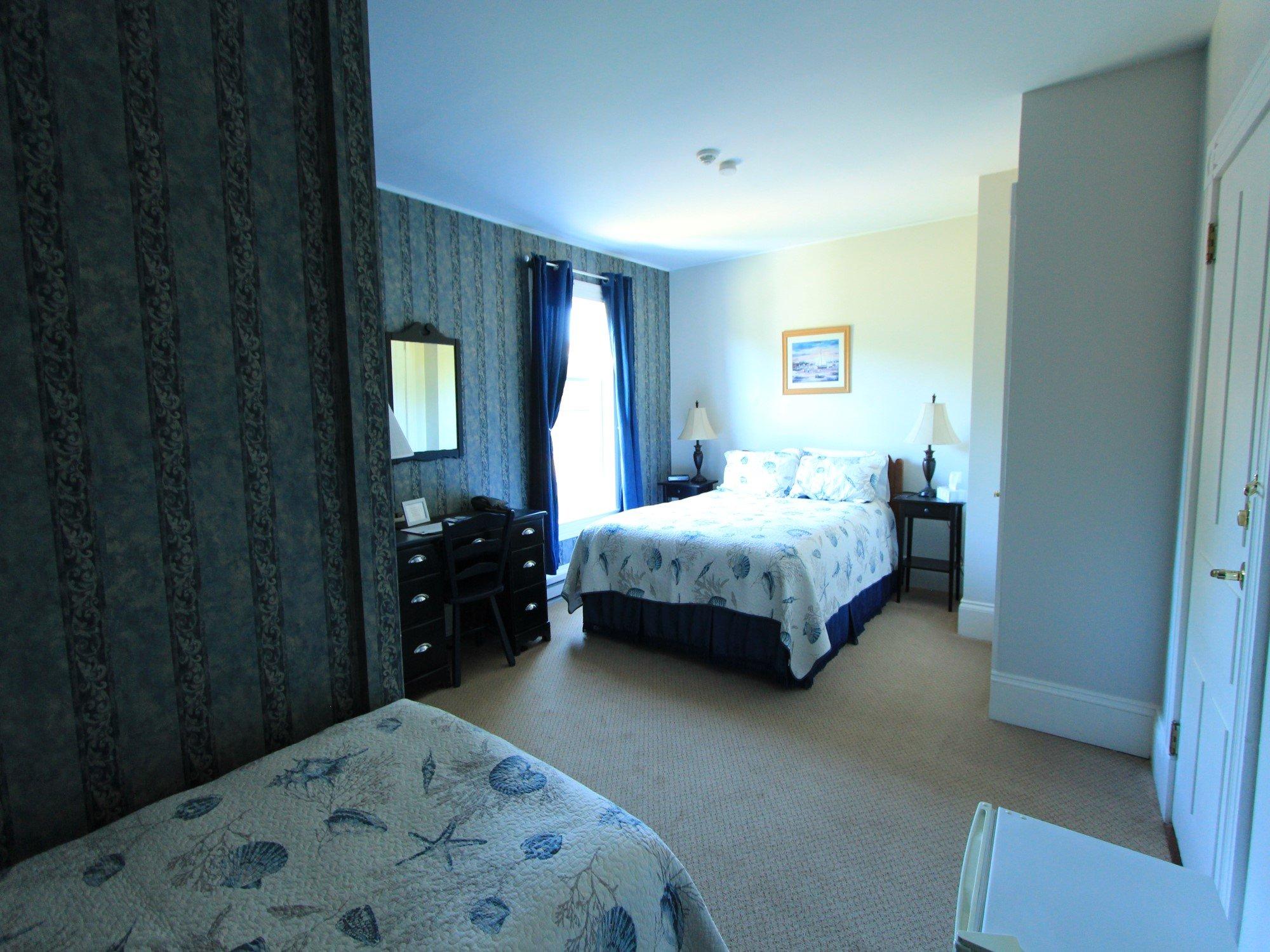 Room 8 Queen bed plus Single Bed