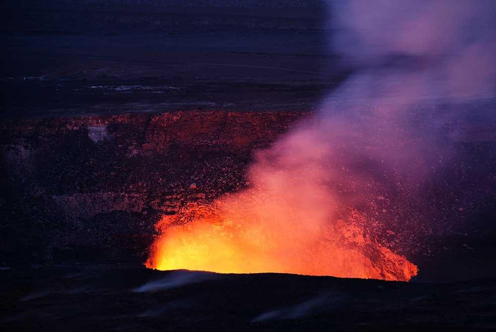 errupting volcano at night