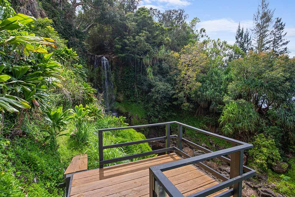 Patio with view of waterfall