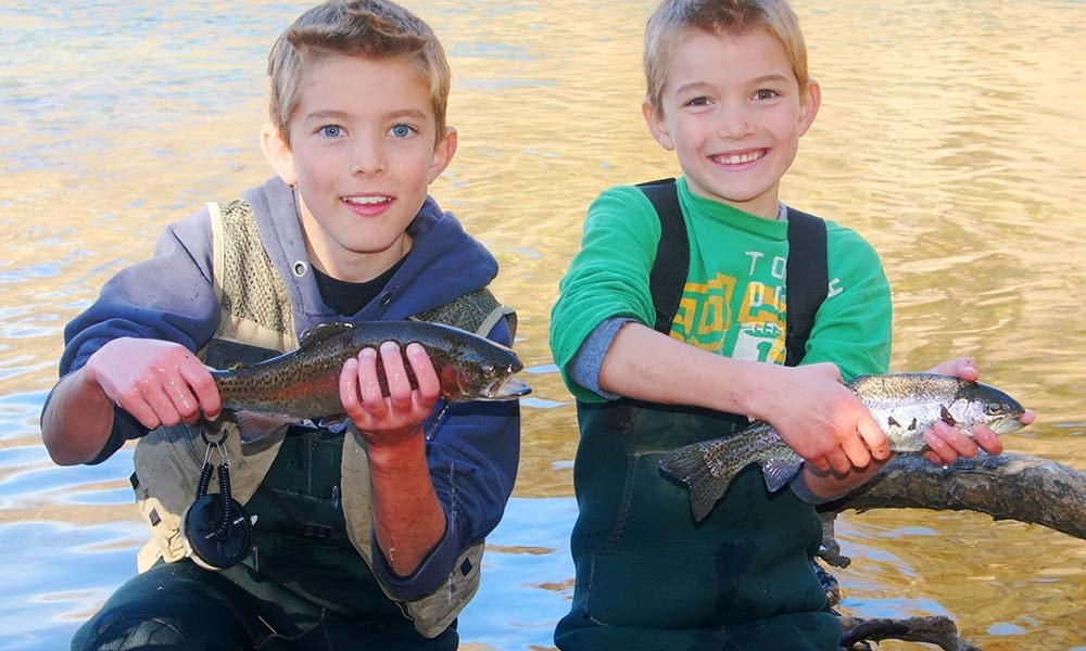 young boys trout fishing