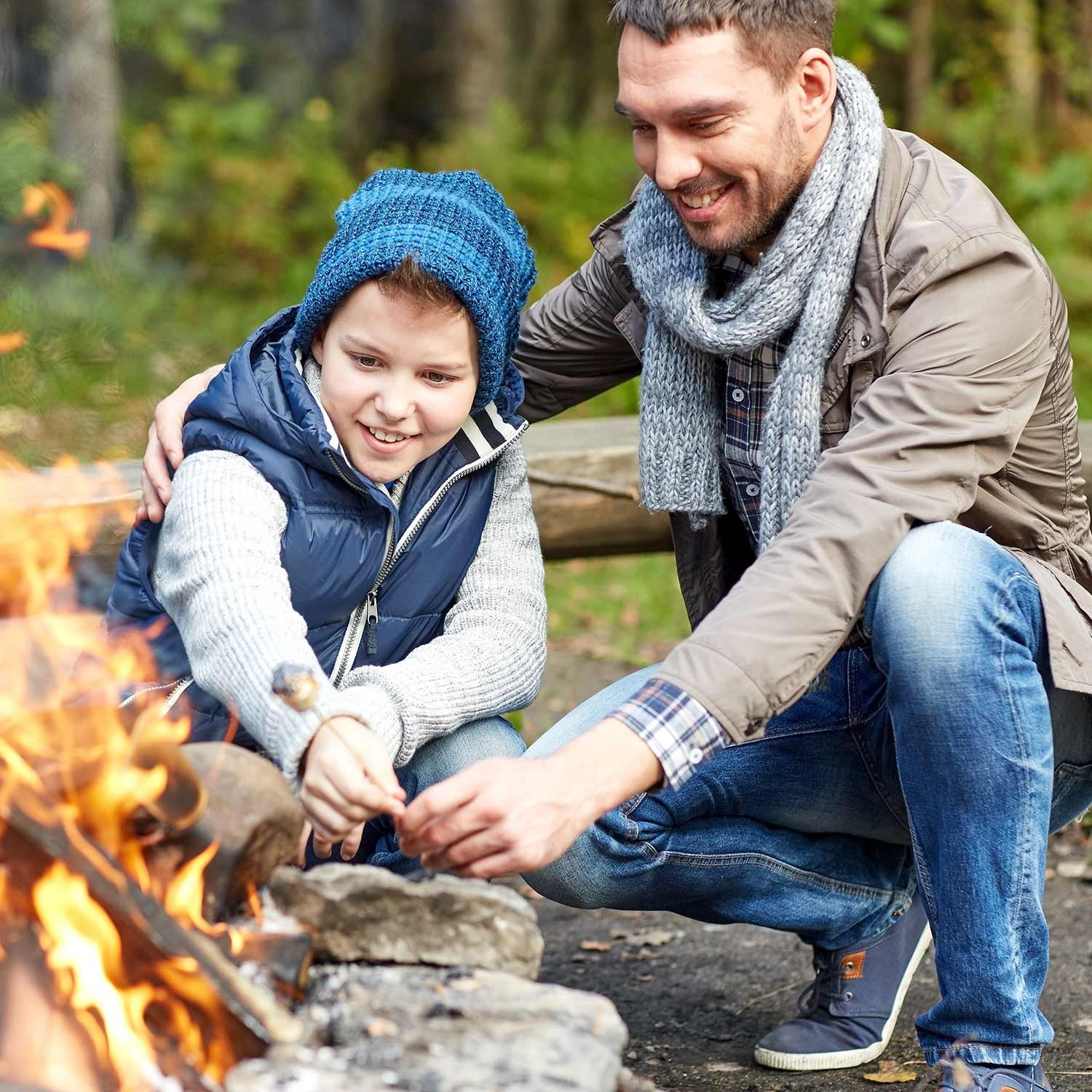 father and son roasting smores