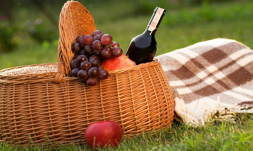 picnic basket with fruit and wine
