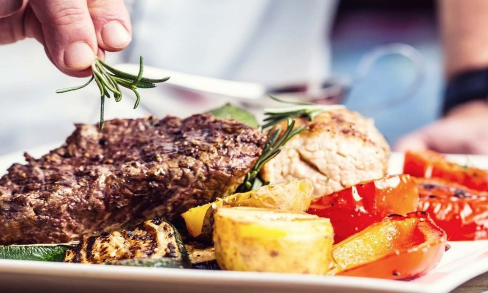 meat and vegetables garnished with rosemary
