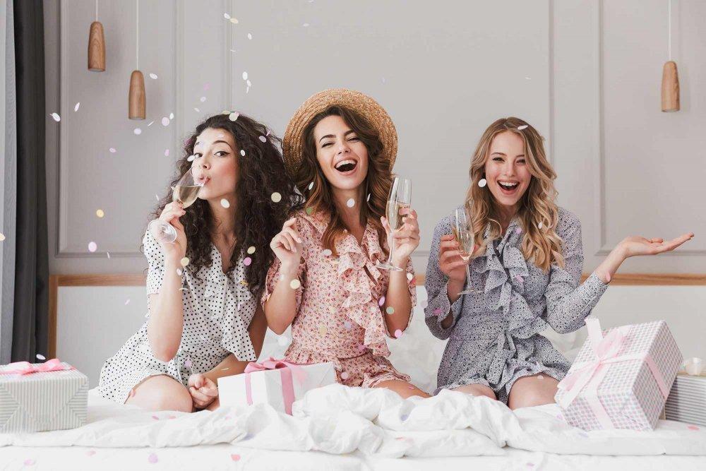 three women drinking champagne