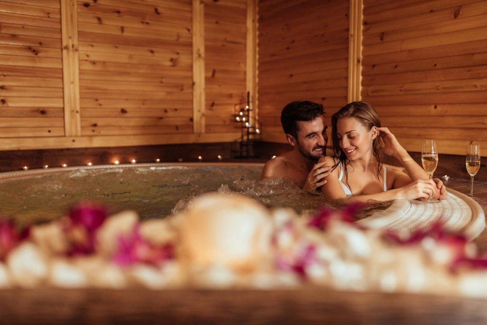 man and woman in hot tub