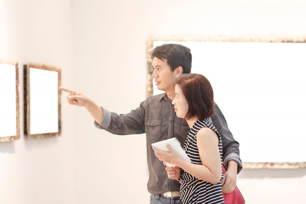 young couple looking at art in a museum