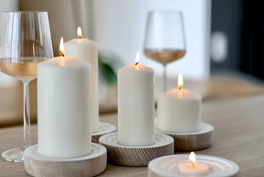 lit candles next to glasses of wine