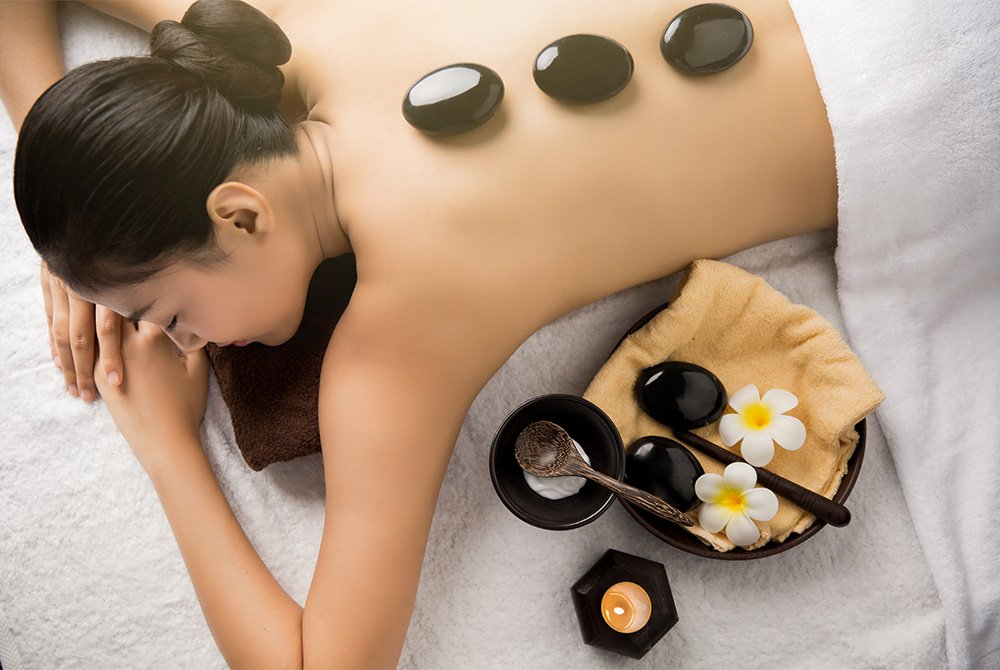woman getting a hot stone massage