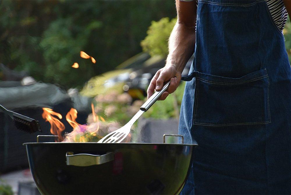 man at a grill