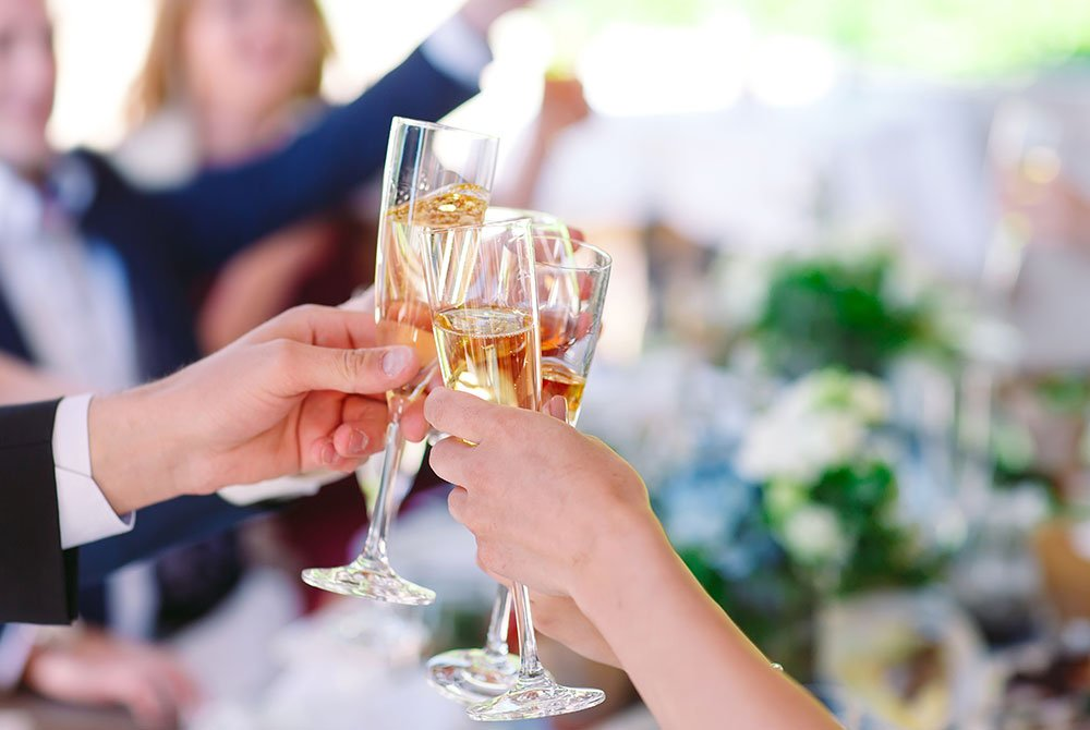 people raising glasses of champagne