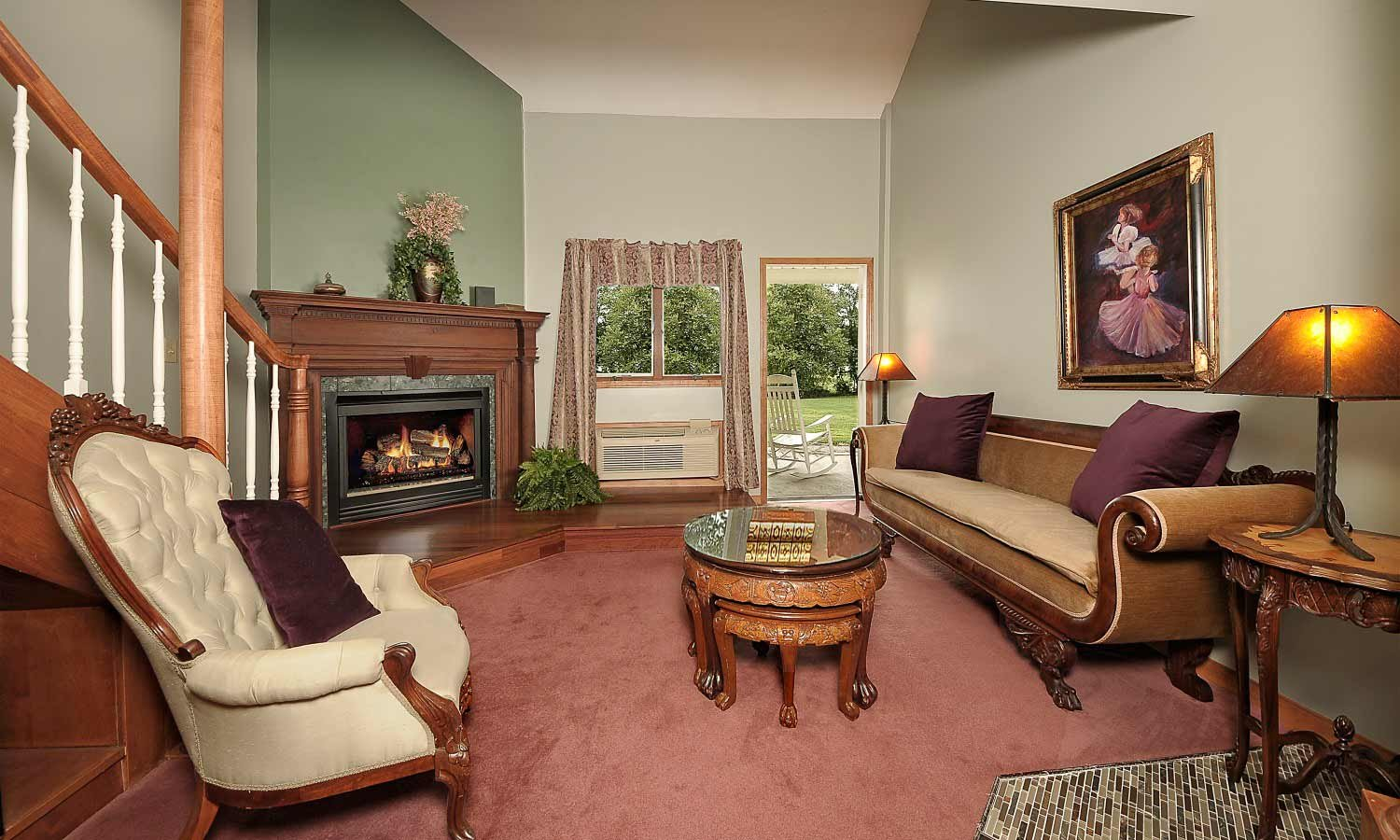Napoleon Loft Suite with couch and fireplace