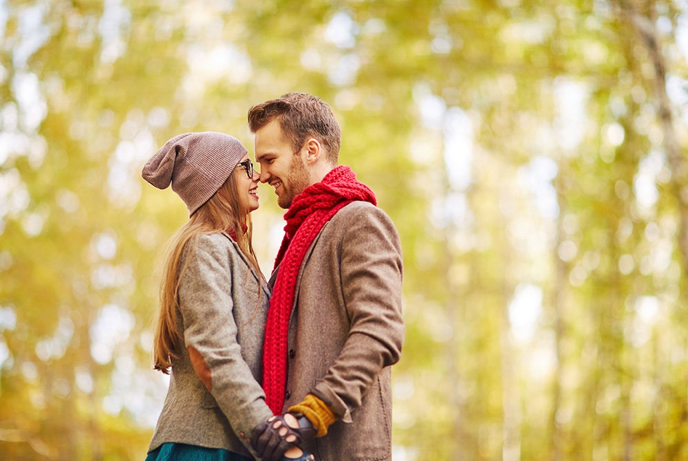 Couple holding hands in fall