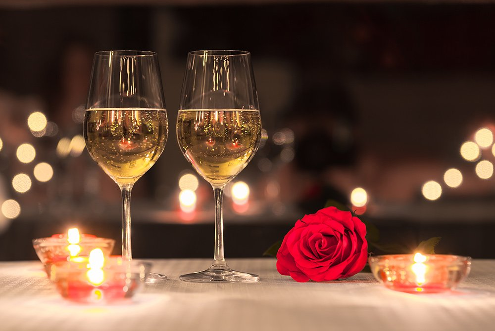 wine and candles with a rose