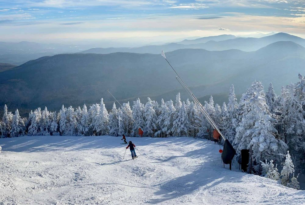 People skiing down a mountain at a ski resort