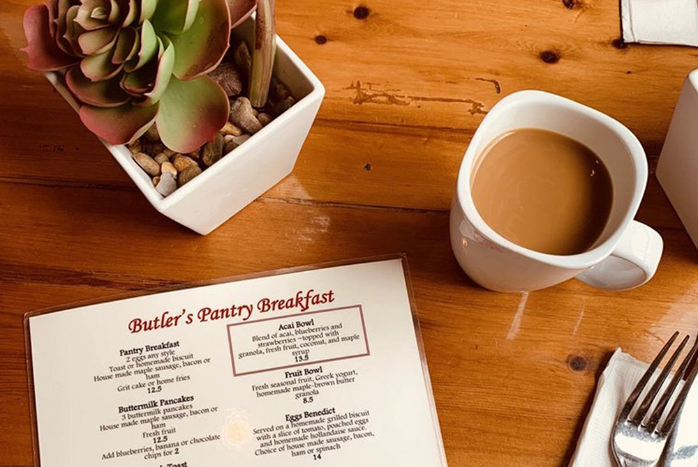 view of Butler's Pantry Breakfast menu with coffee and succulent