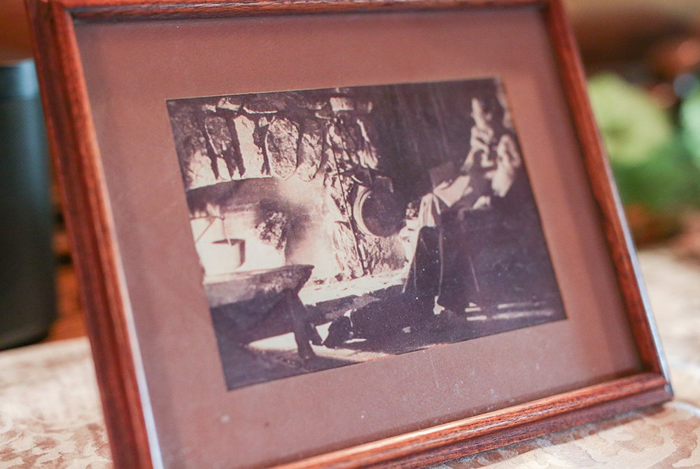 Framed picture of couple infront of fireplace
