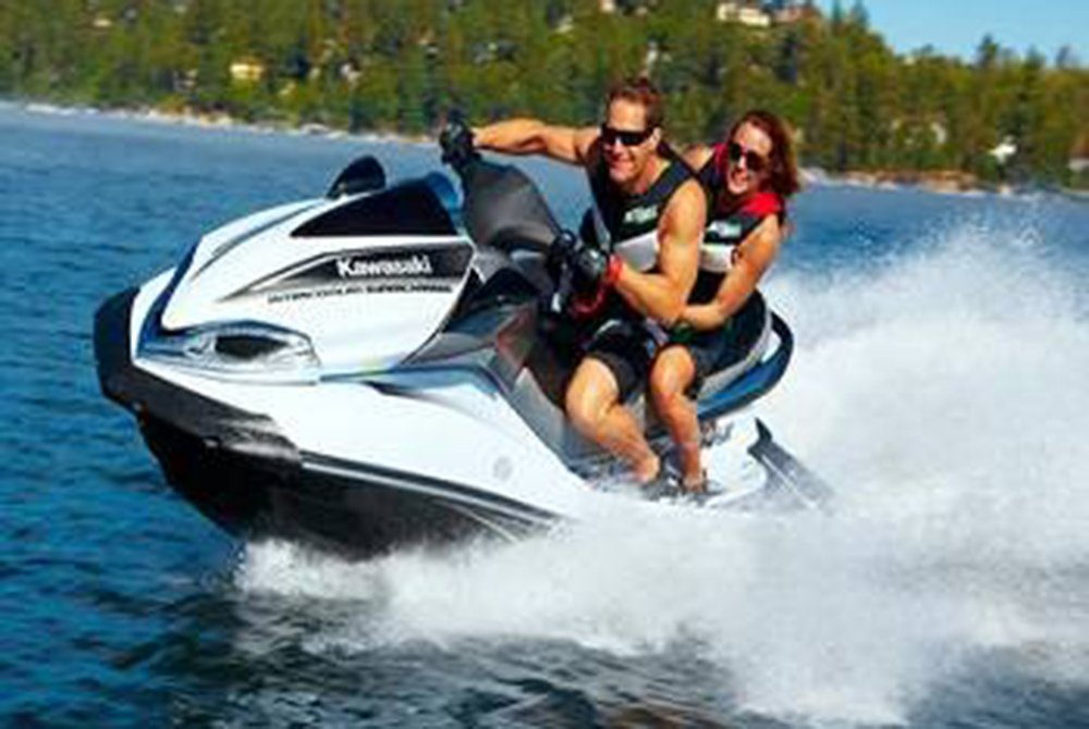 Couple jet skiing on lake