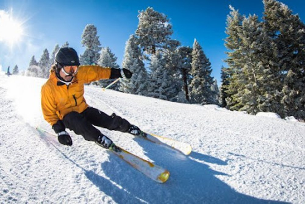 Person skiing down mountain side