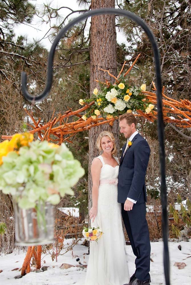 Bride and groom smiling during winter ceremony
