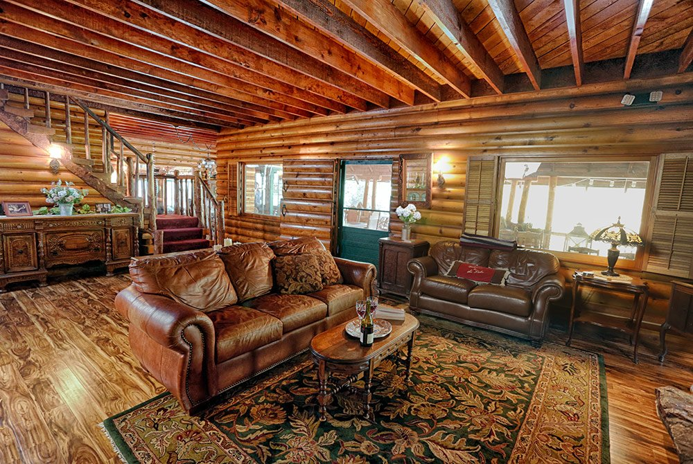 Great room with leather seats and staircase