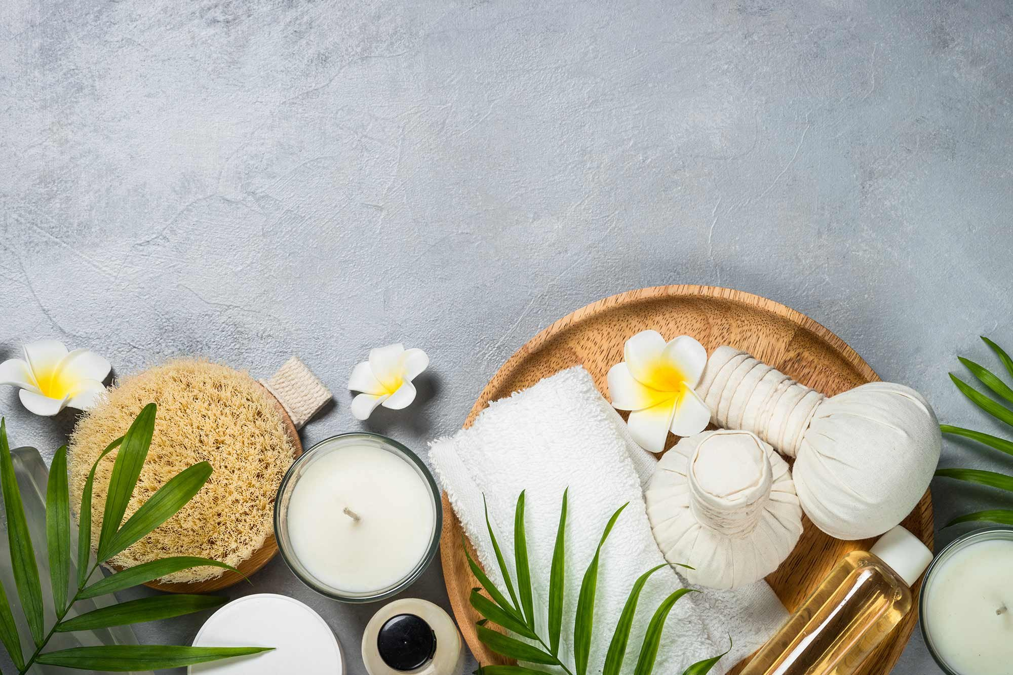spa materials in basket with flowers