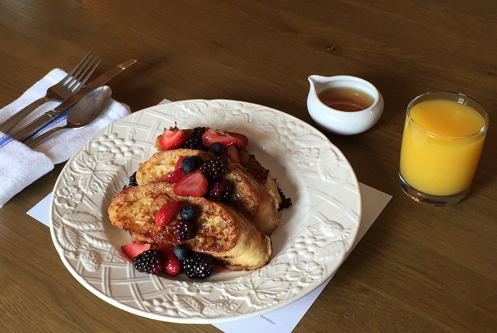 french toast with fruit and orange juice