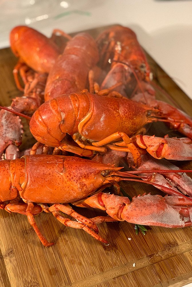 lobsters on a cutting board