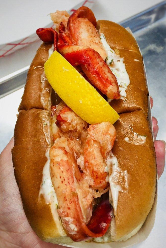 lobster on bun with lemon wedge
