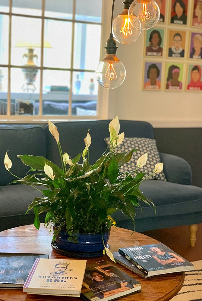 flowers and books on table