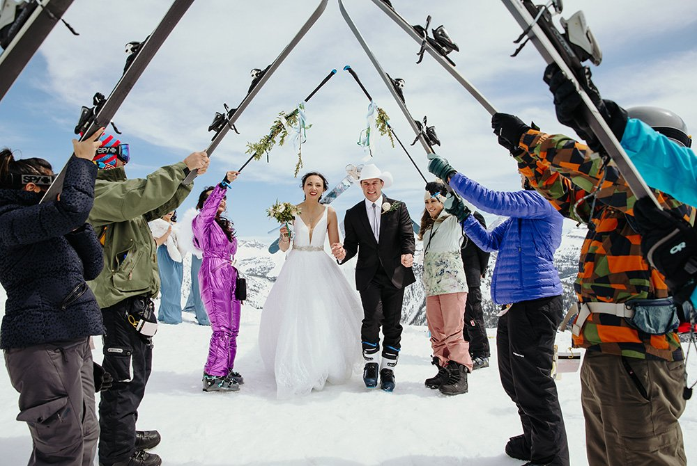 bride and groom eloping on a ski slope