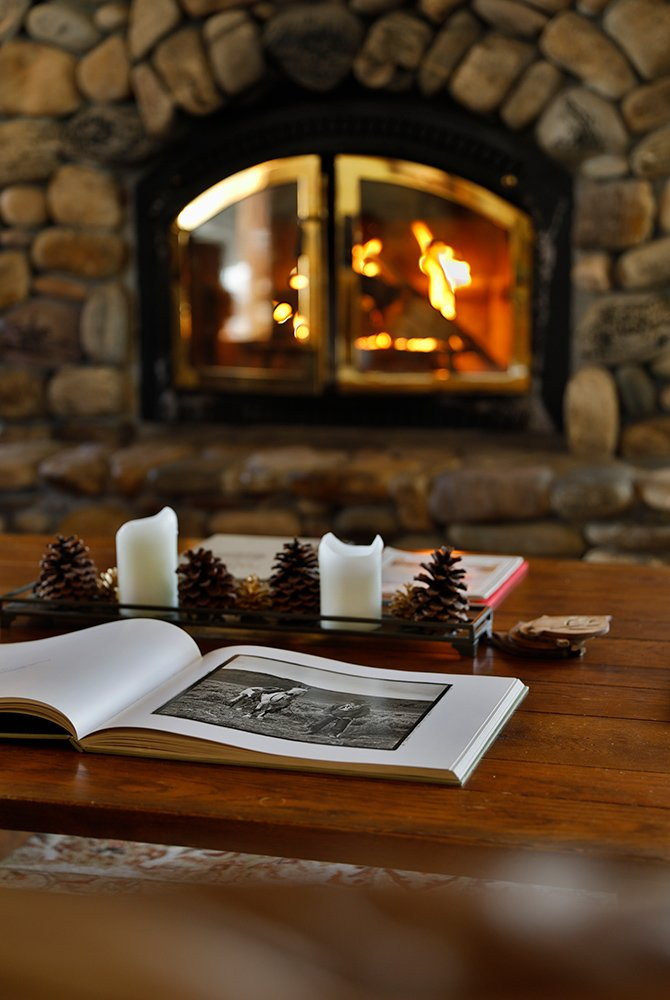 Photobook on a table with fireplace in the background