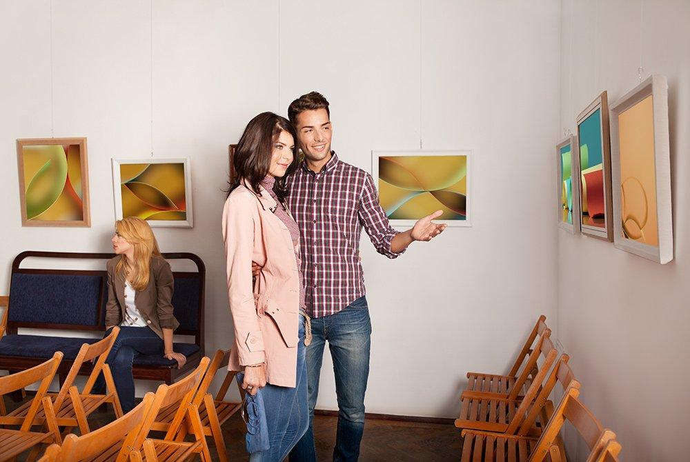 Couple standing in art gallery