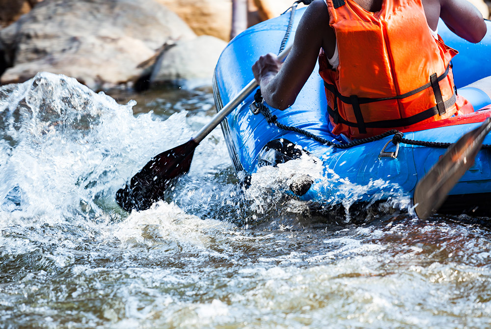 Person river rafting