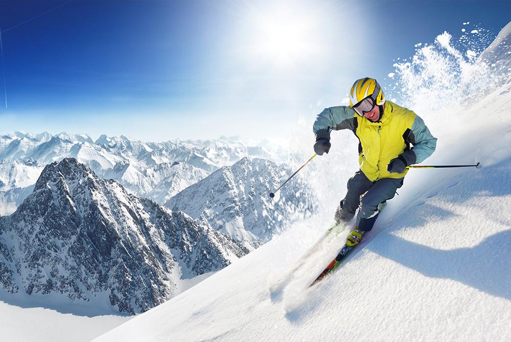Man skiing down mountain